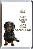 A fridge magnet with a picture of a Smooth Coated Dachshund Dog with the wording KEEP CALM AND LOVE YOUR DACHSHUND